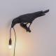 Seletti Bird Looking wandlamp links buiten